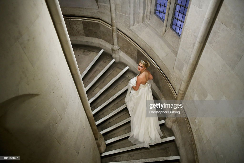 Debutante Eloise Knight, aged 17, makes her way through the Royal Courts of Justice during the Queen Charlotte's Ball on October 26, 2013 in London, England. Queen Charlotte's Ball is the pinnacle event in the London Season. The London Season is rich in history and was formed over two hundred years ago when the custom of returning to London at the end of the hunting season was celebrated with glittering balls and high society events. The modern group of meticulously selected debutantes continue the tradition and celebrate their year of charity fund raising, etiquette classes and debut at The Queen Charlotte's Ball. The young ladies, usually aged between 17 and 20 and wearing designer dresses, attend the grand ball where they are presented to guests and curtsey to the Queen Charlotte Cake. King George III introduced the Queen Charlotte's Ball in 1780 to celebrate his wife's birthday and debutantes were traditionally presented to the King or Queen until 1958.