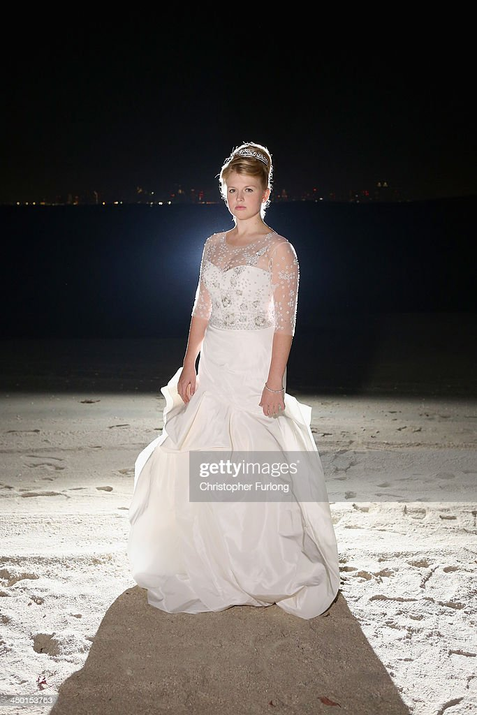 Debutante Eloise Knight, aged 17, poses on the beach of Royal Island during The London Season Ball on The World on November 14, 2013 in Dubai, United Arab Emirates. Debutantes, royalty and aristocracy, attended The London Season Ball on the World hosted on the exclusive and privately owned Royal Island off the coast of Dubai. The ball follows the tradition of the historical Queen Charlotte's Ball held annually in London. The ball is the inaugural party of the London Season Academy in Dubai, offering classes in etiquette in social and business protocol.