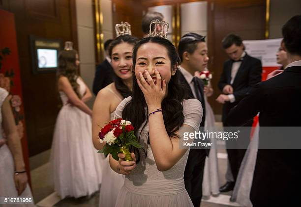 A debutante from a local academy laughs as she and others wait before taking part in the Vienna Ball at the Kempinski Hotel on March 19 2016 in...