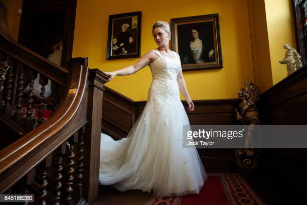 Debutante Lauren Evans from Haslemere makes her way down the stairs at Boughton Monchelsea Place ahead of the Queen Charlotte's Ball on September 9...
