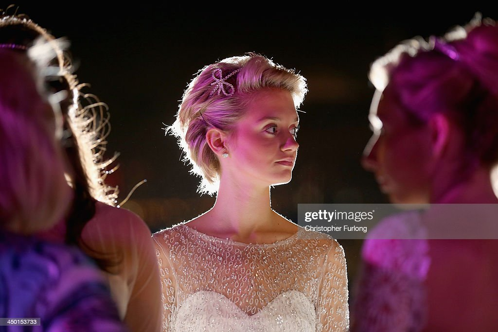 Debutante Nicole Gilmer, aged 17, waits with other debutantes for the arrival of guests during The London Season on The World Ball on November 14, 2013 in Dubai, United Arab Emirates. Debutantes, royalty and aristocracy, attended The London Season Ball on the World hosted on the exclusive and privately owned Royal Island off the coast of Dubai. The ball follows the tradition of the historical Queen Charlotte's Ball held annually in London. The ball is the inaugural party of the London Season Academy in Dubai, offering classes in etiquette in social and business protocol.