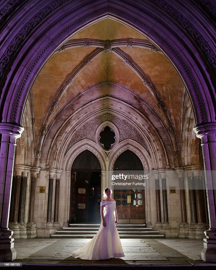 Debutante of the Year Maria Austin poses on the steps of the Royal Courts of Justice during the Queen Charlotte's Ball on October 26 2013 in London...