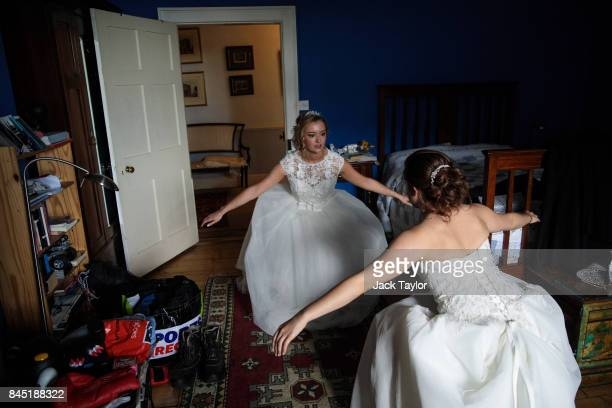 Debutante Olivia Mott from Charlottesville Virginia practices her curtsy at Boughton Monchelsea Place ahead of the Queen Charlotte's Ball on...