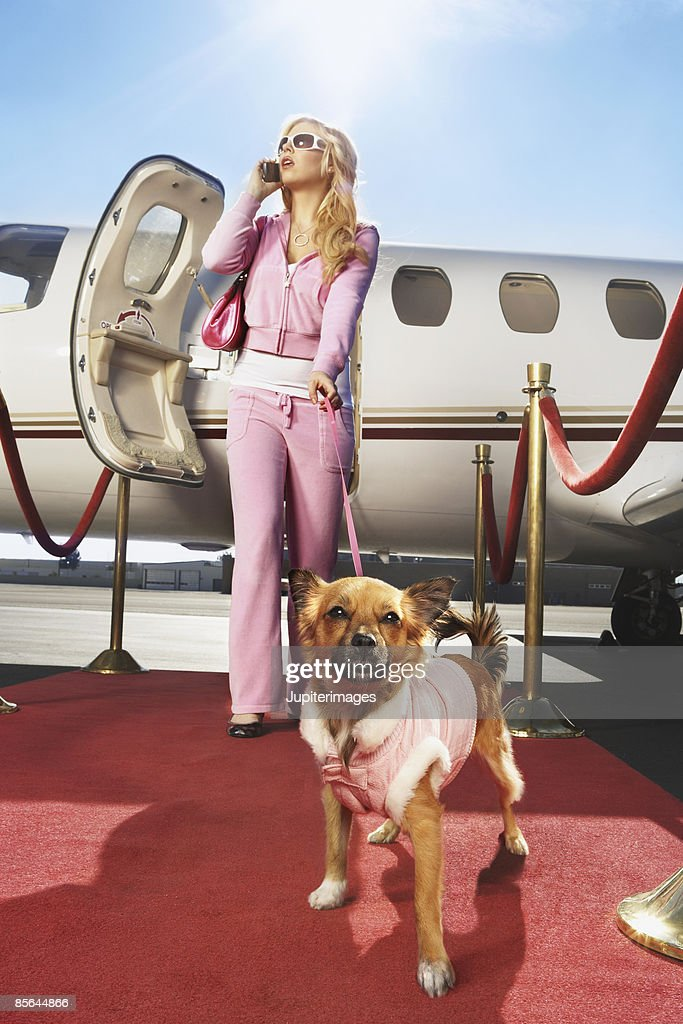 Debutante with airplane and red carpet : Stock Photo