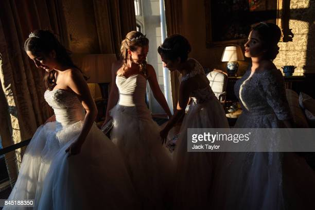 Debutantes adjust their dresses at Leeds Castle during the Queen Charlotte's Ball on September 9 2017 in Maidstone England In 1780 the first...