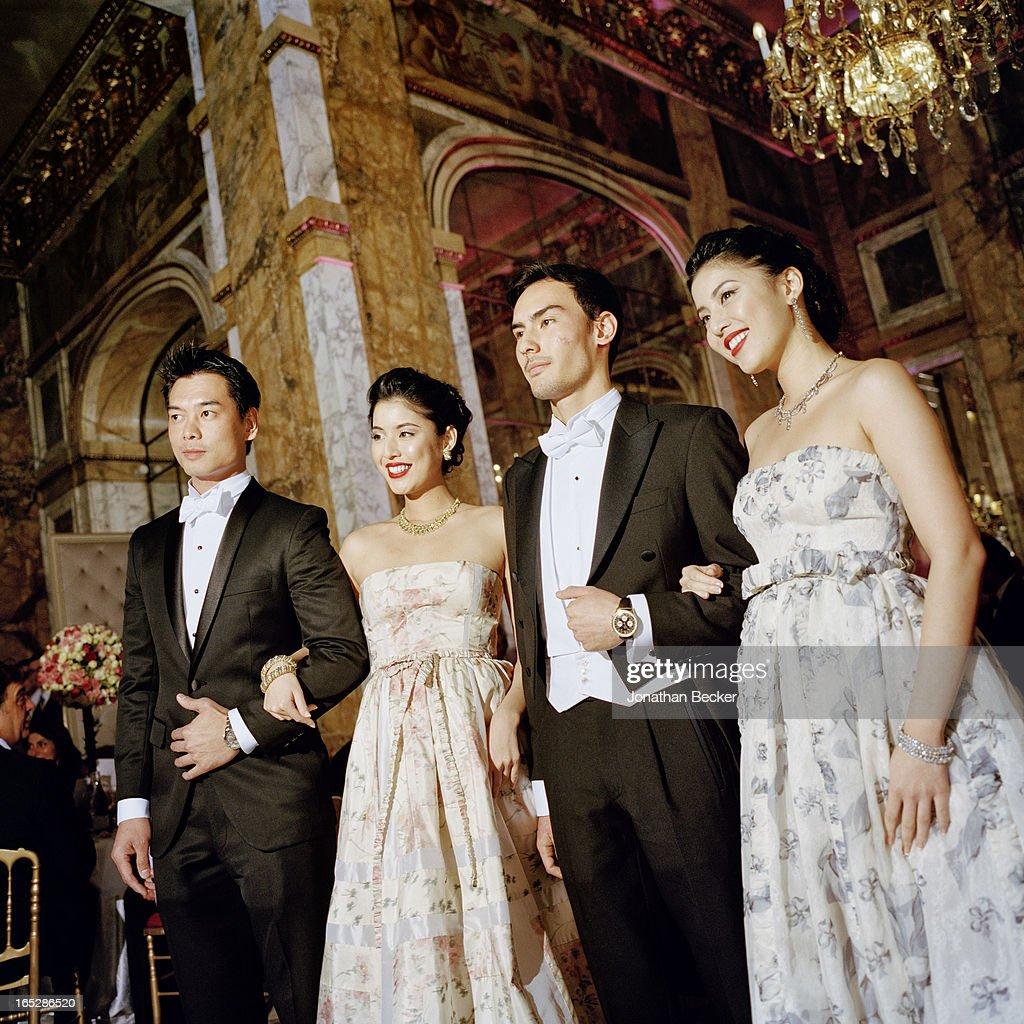 Debutantes and escorts Xuan Mu, Miyuki Uramune, Ken Foulfoin and Ikue Uramune photographed at the Crillon Debutante Ball for Vanity Fair Magazine on November 22, 2012 in Paris, France. PUBLISHED