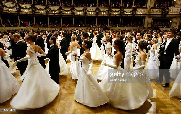 Debutantes and their escorts perform a dance at the Vienna Opera Ball at the city's opera house February 19 2004 in Vienna Austria