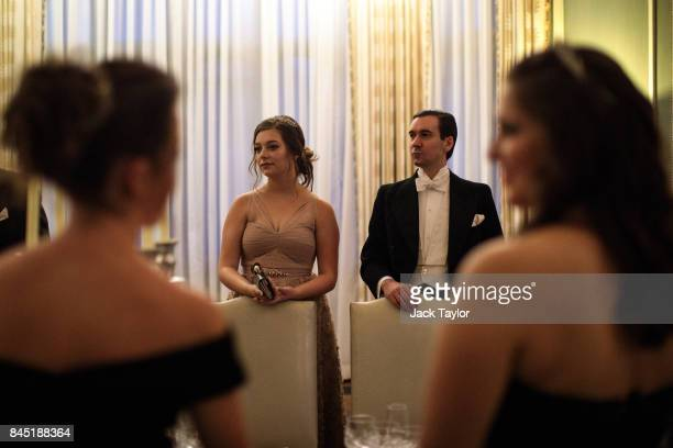 Debutantes and their escorts prepare to sit down for dinner at Leeds Castle during the Queen Charlotte's Ball on September 9 2017 in Maidstone...