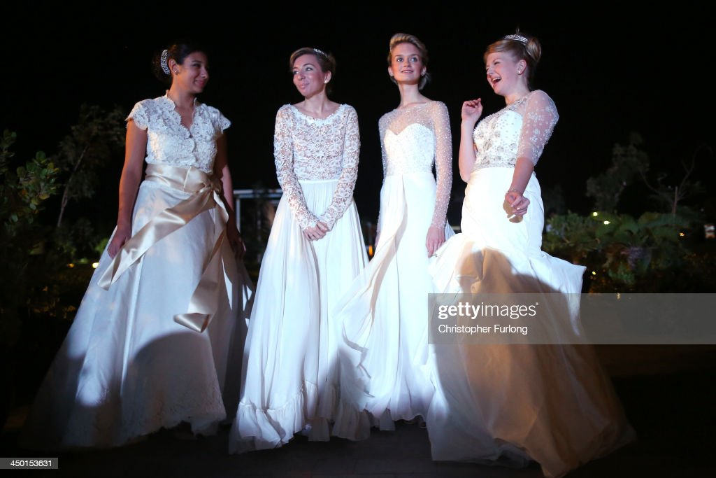 Debutantes Anna Zaphiriou-Zarifi, Isabella Robinson, Nicole Gilmer and Eloise Knight wait for the arrival of guests during the The London Season on The World Ball on November 14, 2013 in Dubai, United Arab Emirates. Debutantes, royalty and aristocracy, attended The London Season Ball on the World hosted on the exclusive and privately owned Royal Island off the coast of Dubai. The ball follows the tradition of the historical Queen Charlotte's Ball held annually in London. The ball is the inaugural party of the London Season Academy in Dubai, offering classes in etiquette in social and business protocol.