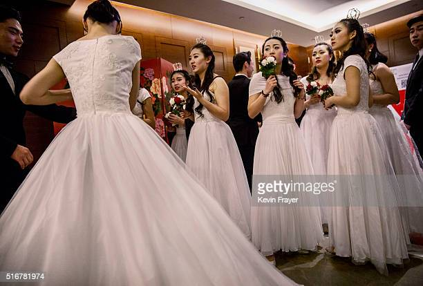 Debutantes from a local academy gather before taking part in the Vienna Ball at the Kempinski Hotel on March 19 2016 in Beijing China The ball which...