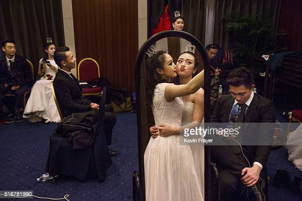 Debutantes from a local academy take a selfie as they and others get ready to take part in the Vienna Ball at the Kempinski Hotel on March 19 2016 in...