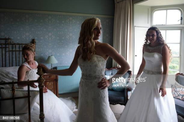 Debutantes Lauren Evans Amira Rayner 19 and Eliza Lewis 17 prepare at Boughton Monchelsea Place ahead of the Queen Charlotte's Ball on September 9...