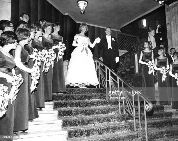 Debutantes make their bows at Society ball Debentures Martha Wright is presented by her father Richard W Wright as they descend the stairs into the...