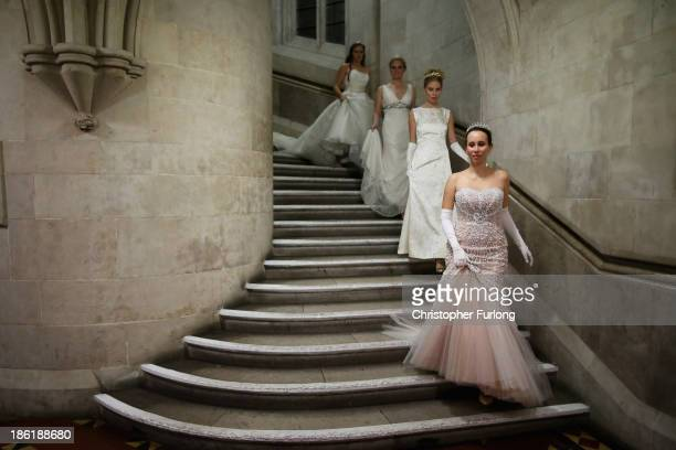 Debutantes make their way to the main hall during the Queen Charlotte's Ball at the Royal Courts of Justice on October 26 2013 in London England...