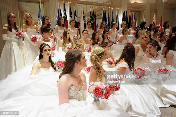 Debutantes pose for a photo during the 60th International Debutante Ball at The Waldorf=Astoria on December 29 2014 in New York City