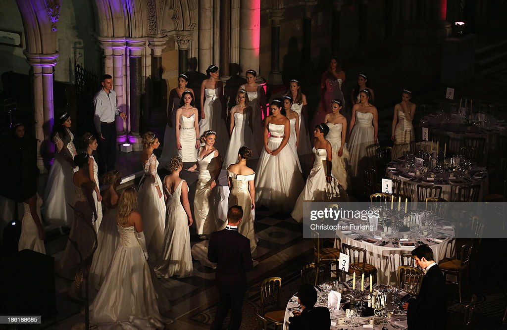 Debutantes rehearse their curtsey during the Queen Charlotte's Ball at the Royal Courts of Justice on October 26 2013 in London England Queen...