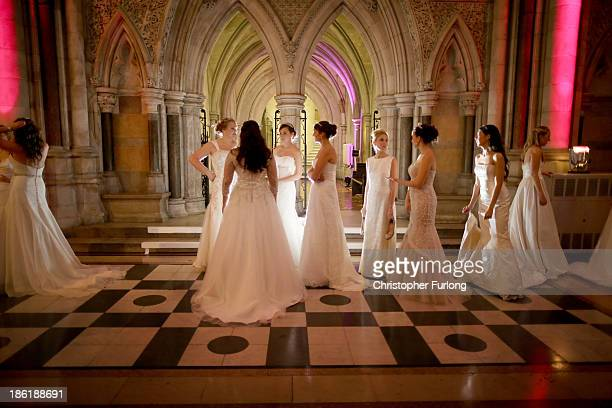 Debutantes wait in line to be presented to guests during the Queen Charlotte's Ball at the Royal Courts of Justice on October 26 2013 in London...