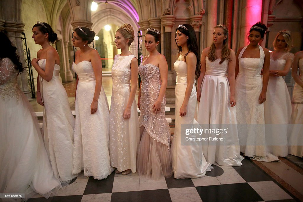 Debutantes wait nervously in line to be presented to guests during the Queen Charlotte's Ball at the Royal Courts of Justice on October 26, 2013 in London, England. Queen Charlotte's Ball is the pinnacle event in the London Season. The London Season is rich in history and was formed over two hundred years ago when the custom of returning to London at the end of the hunting season was celebrated with glittering balls and high society events. The modern group of meticulously selected debutantes continue the tradition and celebrate their year of charity fund raising, etiquette classes and debut at The Queen Charlotte's Ball. The young ladies, usually aged between 17 and 20 and wearing designer dresses, attend the grand ball where they are presented to guests and curtsey to the Queen Charlotte Cake. King George III introduced the Queen Charlotte's Ball in 1780 to celebrate his wife's birthday and debutantes were traditionally presented to the King or Queen until 1958.