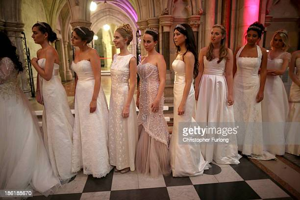 Debutantes wait nervously in line to be presented to guests during the Queen Charlotte's Ball at the Royal Courts of Justice on October 26 2013 in...