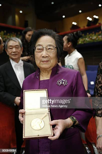 STOCKHOLM Dec 10 2015 2015's Nobel laureate in Physiology or Medicine Tu Youyou left shows her medal following the Nobel Prize award ceremony at the...