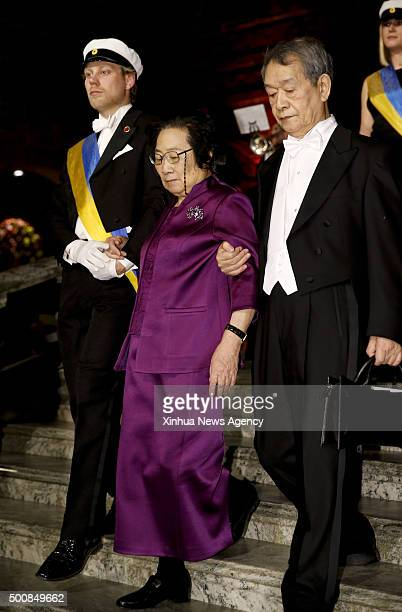 STOCKHOLM Dec 10 2015 2015's Nobel laureate in Physiology or Medicine Tu Youyou center and her husband Li Tingzhao right attend traditional Nobel...