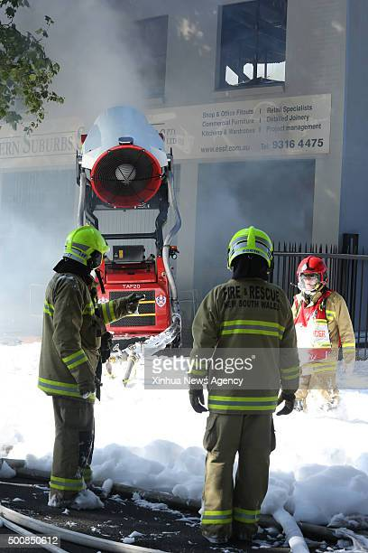 SYDNEY Dec 10 2015 Photo taken on Nov 30 2015 shows firefighters standing with Australia's first remote controlled fire fighting robot in Sydney...