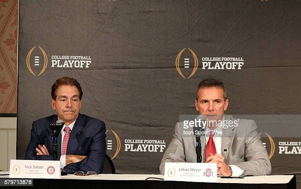 Dec 11 2014 Lake Buena Vista FL USA Alabama Crimson Tide head coach Nick Saban and Ohio State Buckeyes head coach Urban Meyer address the media...