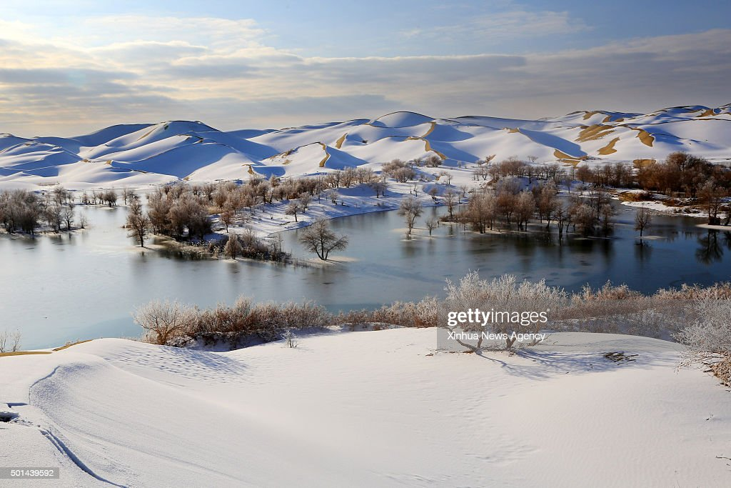 YULI Dec 15 2015 Photo taken on Dec 14 2015 shows the snow scenery on the Taklimakan Desert in Yuli County northwest China's Xinjiang Uygur...