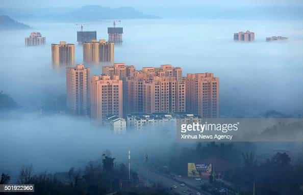 CHONGQING Dec 18 2015 Photo taken on Dec 17 2015 shows buildings shrouded by clouds in Chongqing southwest China
