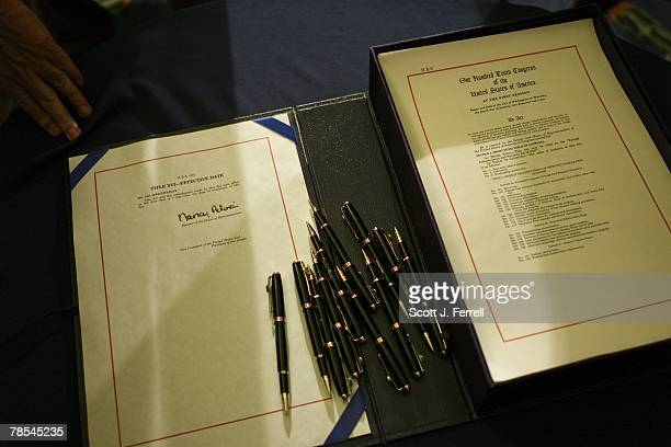 House Speaker Nancy Pelosi DCalif signed her name several times during an enrollment ceremony for the energy bill passed by the House earlier Tuesday...