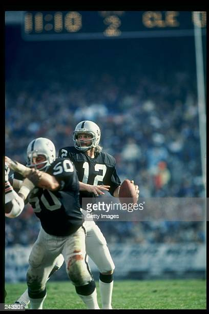 Quarterback Ken Stabler of the Oakland Raiders prepares to pass the ball during a game against the Cleveland Browns at the OaklandAlameda County...
