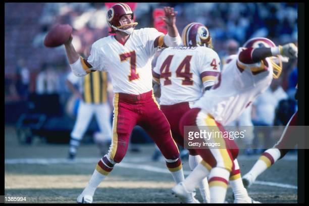 Washington Redskins quarterback Joe Theismann throws a pass during game against the Los Angeles Rams at Anaheim Stadium in Anaheim California The...