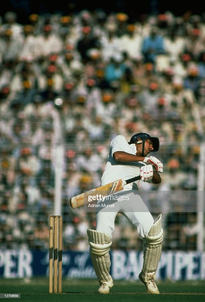 Ravi Shastri of India dodges a bouncer from Malcolm Marshall of the West Indies during the Fifth Test match at Eden Gardens in Calcutta India The...