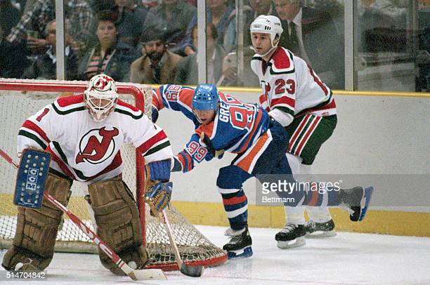 Wayne Gretzy Edmonton Oilers hockey star in action behind net