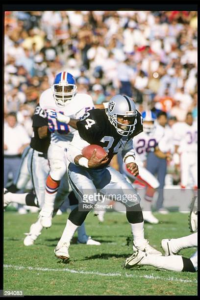 Runningback Bo Jackson of the Los Angeles Raiders runs down the field during a game against the Denver Broncos at the Los Angeles Coliseum in Los...