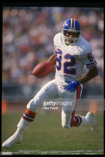 Wide receiver Vance Johnson of the Denver Broncos runs with the ball during a game against the Los Angeles Raiders at the Coliseum in Los Angeles...