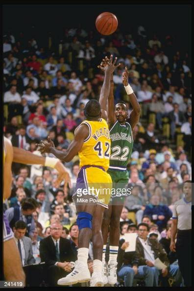 Guard Rolando Blackman of the Dallas Mavericks shoots over the outstretched arms of forward James Worthy of the Los Angeles Lakers during a game...