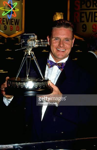Paul Gascoigne of England shows off his award during the Sports Review of the Year ceremony in London Mandatory Credit Howard Boylan/Allsport