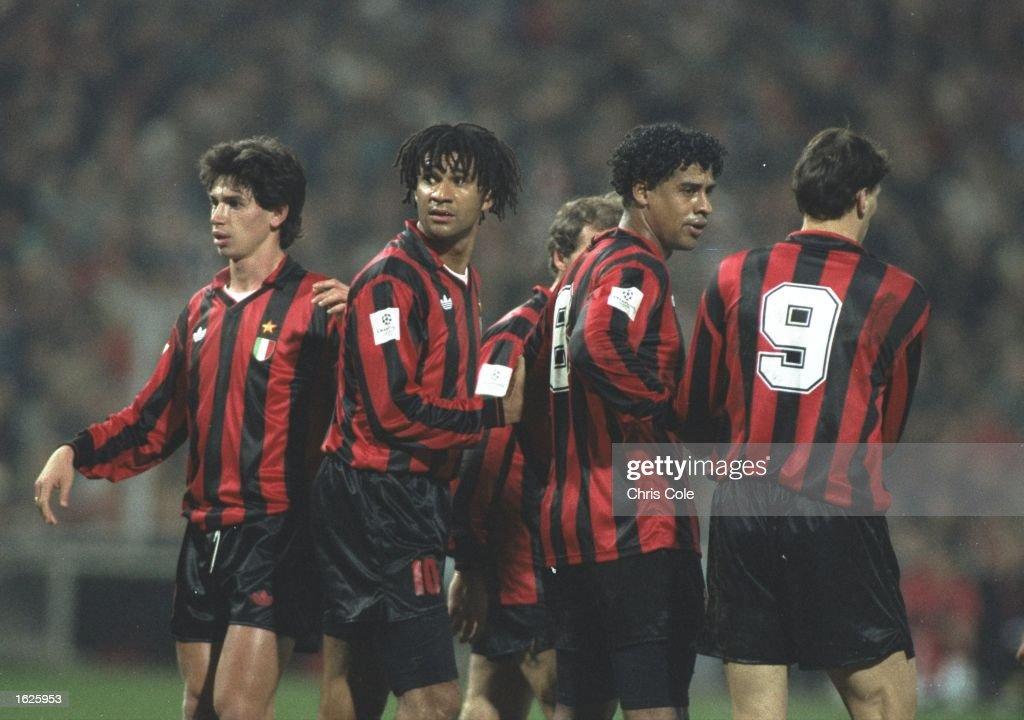 AC Milan Players Demetrio Albertini Ruud Gullit Frank Rijkaard and Marco Van Basten form a wall in the European Cup match against PSV Eindhoven AC...
