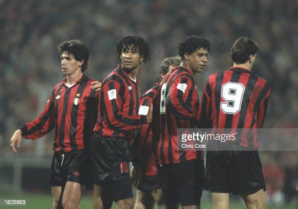 AC Milan Players Demetrio Albertini Ruud Gullit Frank Rijkaard and Marco Van Basten form a wall in the European Cup match against PSV Eindhoven AC...