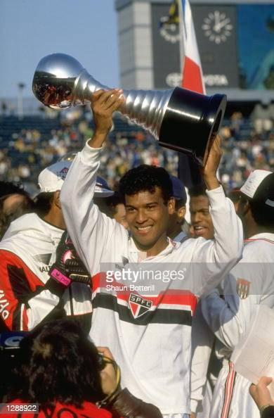 Muller of Sao Paulo holds the trophy aloft after the Toyota Europe versus South America Cup final against Barcelona Sao Paulo won the match 21...