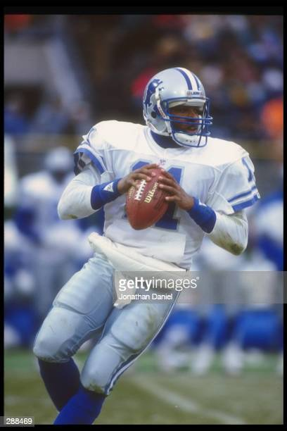 Quarterback Andre Ware of the Detroit Lions looks to pass the ball during a game against the Green Bay Packers at Milwaukee County Stadium in...