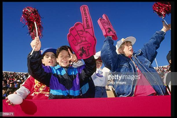 Fans of the Texas Tech Red Raiders celebrate during the John Hancock Bowl at the Sun Bowl in El Paso Texas Mandatory Credit Allsport /Allsport