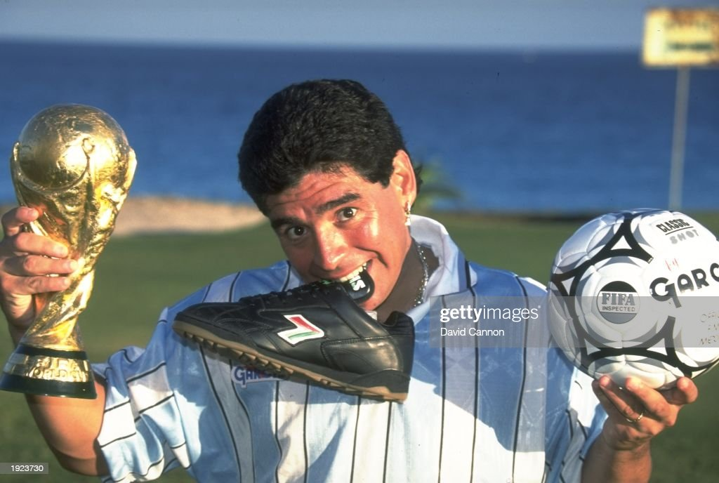 Portrait of Diego Maradona of Argentina with his World Cup trophy, boot and ball in Cancun, Mexico. \ Mandatory Credit: David Cannon/Allsport