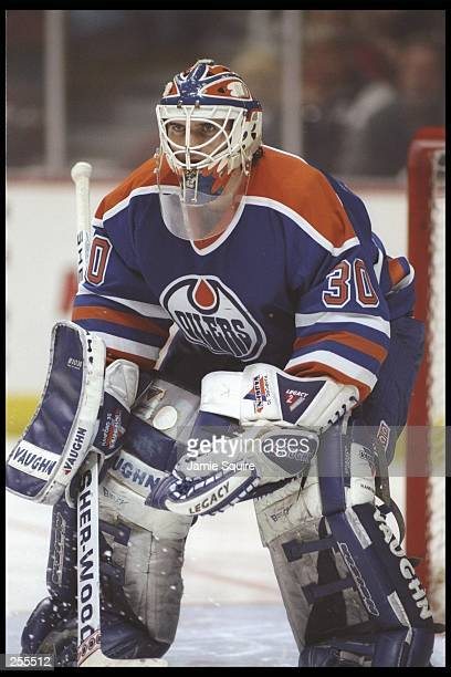 Goaltender Bill Ranford of the Edmonton Oilers looks on during a game against the Anaheim Mighty Ducks at Arrowhead Pond in Anaheim California The...