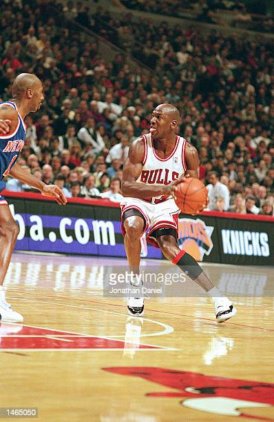 Michael Jordan of the Chicago Bulls dribbles the ball during the game against the New York Knicks at the United Center in Chicago Illinois The Bulls...