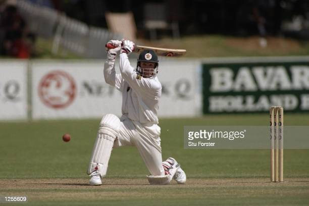 Andy Flower of Zimbabwe on his way to scoring a century during the first test match against England in Bulawayo The match ended in a draw Mandatory...