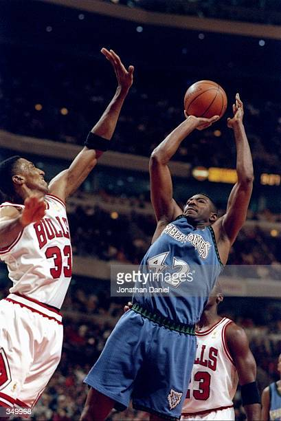 Forward Sam Mitchell of the Minnesota Timberwolves goes up for two as Chicago Bulls guard Scottie Pippen covers him during a game at the United...