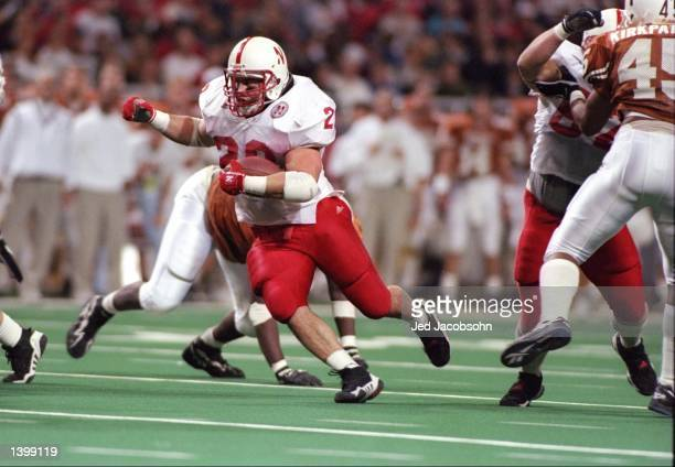 Fullback Brian Schuster of the Nebraska Cornhuskers runs with the football during the Big 12 championship game against the Texas Longhorns at the TWA...
