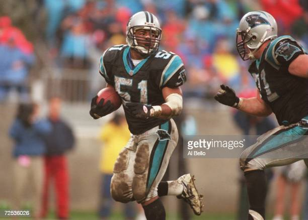 Linebacker Sam Mills of the Carolina Panthers carries the football after a turn over during the Panthers 240 win over the Tampa Bay Buccaneers at...